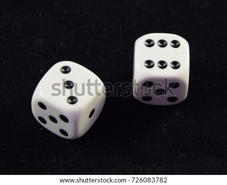 A pair white of dice showing Six and Three