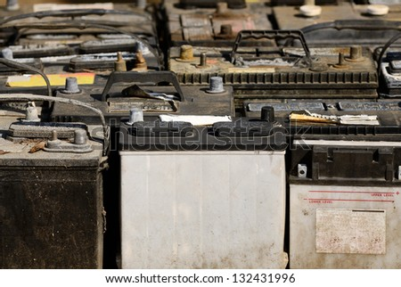 A pallet holds several batteries awaiting recycling at a metal recycling scrap yard - stock photo