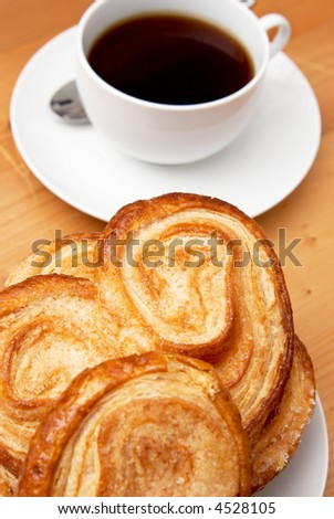 A palmier pastry with black coffee in a white cup - stock photo