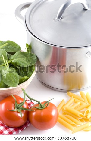 A pan and some ingredients on a white background.