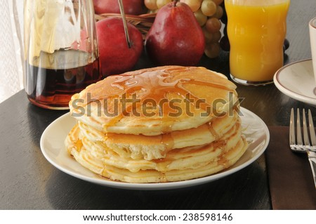 A pancake breakfast with orange juice and coffee - stock photo
