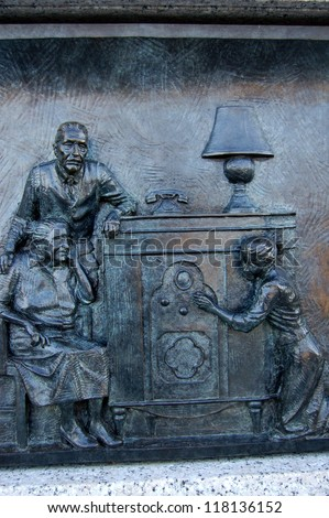 A panel from the National World War II Memorial in Washington, D.C. depicting a family tuning in to the radio to hear the bombing of Pearl Harbor (December 7, 1941) - stock photo