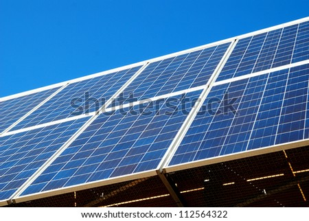 A panel of energy solar cells against sunshine