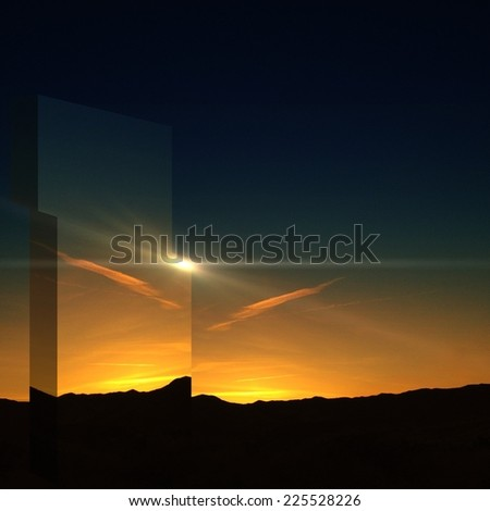 A panorama of a setting sun distorted by a glass object. - stock photo