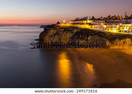 A panorama of Carvoeiro at the dusk in Algarve region, Portugal, Europe - stock photo