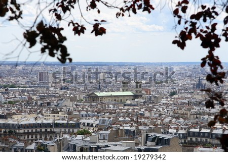 a panorama of Paris through the branches - stock photo