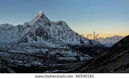 A panorama of the wall Ama Dablam early in the morning - Everest region, Nepal - stock photo
