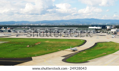 a panorama photo of the airfield at Frankfurt - stock photo