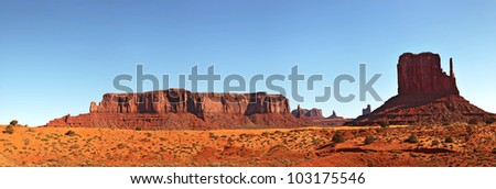 A panorama view of Monument Valley, Utah, USA, against blue sky. - stock photo