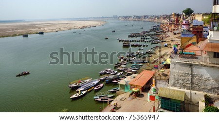 A panoramic bird's eye view of the ancient city of Varanasi with the holy Ganges river flowing by it. - stock photo