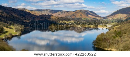 A panoramic image of Grasmere from Loughrigg Terrace on a sunny day.