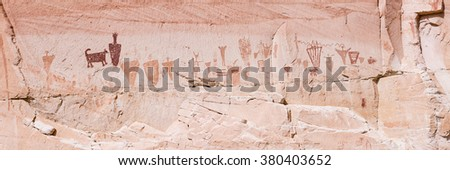 A panoramic image of the Horseshoe Gallery of Barrier Canyon petroglyphs in the remote Horseshoe Canyon Unit of Canyonlands National Park, Utah. - stock photo