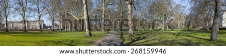A panoramic view of Green Park in the Spring.  Buckingham Palace can be seen in the background on the left hand side. - stock photo