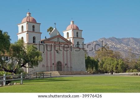 a panoramic view of mission santa barbara against the santa ynez mountains - stock photo