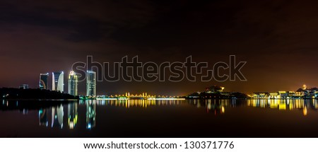 A panoramic view of Putrajaya's lake with reflection at night scene - stock photo