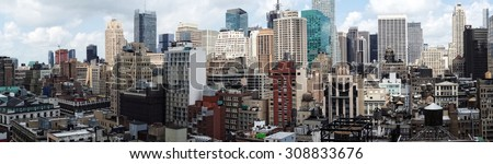 A panoramic view of skyscrapers in New York City.