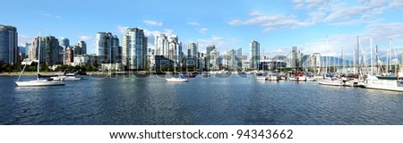 A panoramic view of south Vancouver BC skyline & sailboats in False creek, Canada. - stock photo