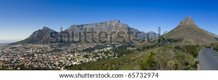 A panoramic view of Table Mountain. Lions Head, Signal Hill and the city bowl of Cape Town, South Africa - stock photo