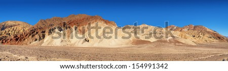 A panoramic view of The Artist's Palette, in Death Valley California, so called because of the natural multi-coloured mineral deposits within the rocks. - stock photo