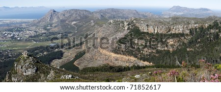 A panoramic view over the southern suburbs of Cape Town, Muizenberg, Tokai forest, Silvermine, False Bay and Cape Point, Cape Town, South Africa. - stock photo