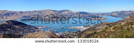 A panoramic wide view of Lyttleton Port and Harbour on an autumn morning from the Gondola at the top of the Port Hills, Christchurch, Canterbury, New Zealand. In the background is Diamond Harbour. - stock photo