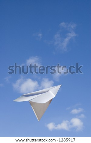 """A Paper airplane keep flying ahead to the higher success -Contain the """"clipping path"""" for the paperplane to let you select on the plane itself and cut/copy it to your design - stock photo"""