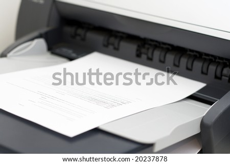 a paper coming out of a printer - stock photo