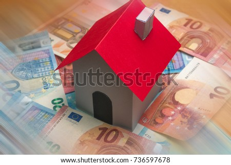 stock-photo-a-paper-house-on-euro-bankno