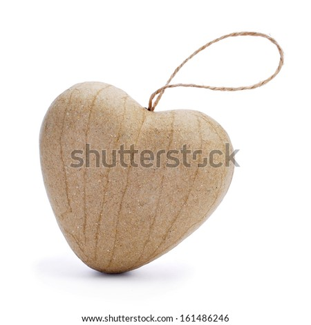 a paperboard heart-shaped ornament on a white background - stock photo