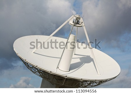 A parabolic satellite dish - stock photo