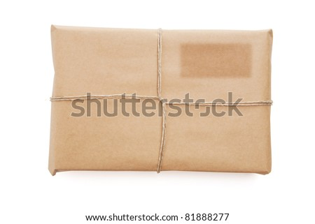 A parcel wrapped in brown paper - stock photo