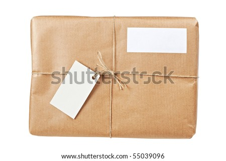 A parcel wrapped in brown paper and tied with rough twine and two blank labels, isolated on white background. Shallow depth of field - stock photo