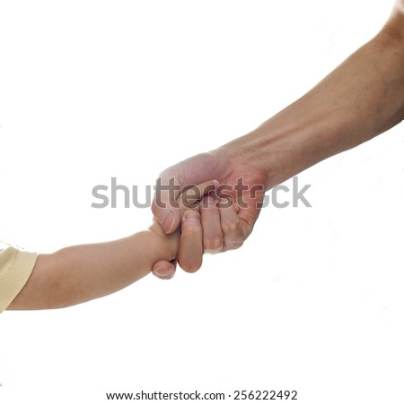 A parent is holding a baby girl's hand, a big hand is holding a small one, isolated, closeup