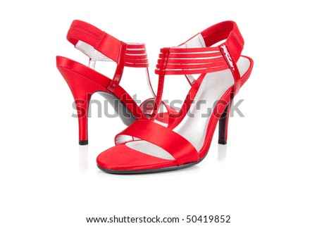 A pari of sexy, red strappy high heel shoes on a white background