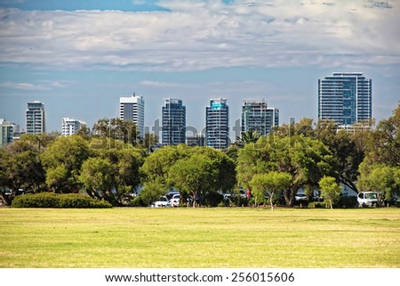 A park with office buildings skylines as a background - stock photo