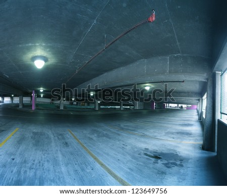 a parking garage with lights and pipes - stock photo