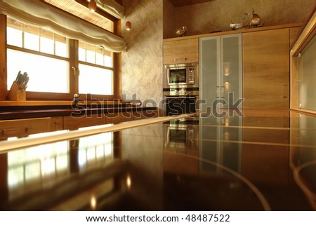 a part of a  kitchen in reflection