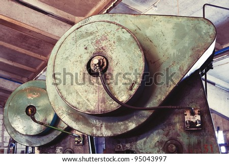 A part of an old industrial rusty electric heavy machinery in the plant - stock photo