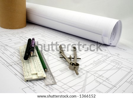 A part of design with a pair of compasses, pencils, pen, ruler and old slideruler - stock photo