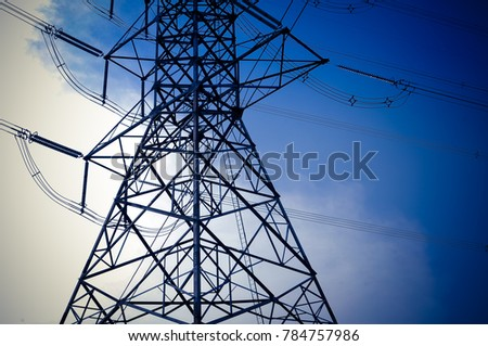 a part of electricity transmission pylon high voltage pole multiple with blue sky abstract