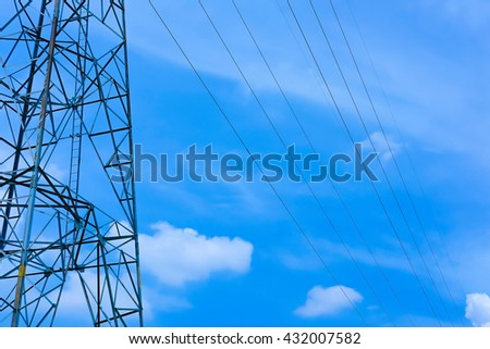 A part of high voltage towers or power poles with beautiful sky and clouds background - stock photo