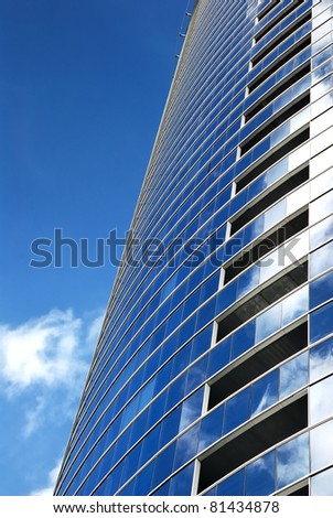 a part of modern business building against blue sky - stock photo