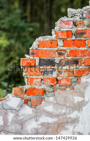 A part of old ruined red brick wall - stock photo