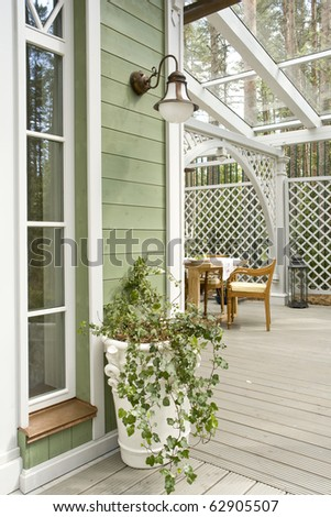 a part of veranda and corner of the house - stock photo