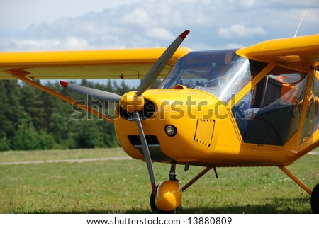 A part of yellow airplane - stock photo