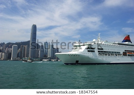 A passenger ship is navigating passes the Victoria channel in Hongkong. - stock photo