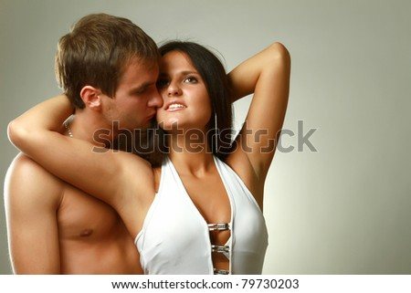 A passionate loving couple, isolated on grey - stock photo
