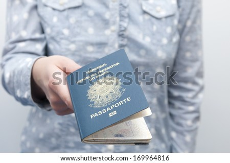 A passport is a government-issued document that certifies the identity and nationality of its holder for the purpose of international travel. - stock photo