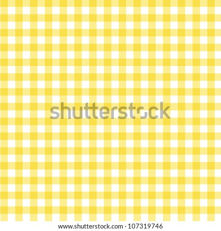 A pastel yellow gingham fabric background that is seamless - stock photo