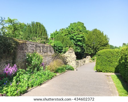 A path in an english garden in the summer - stock photo